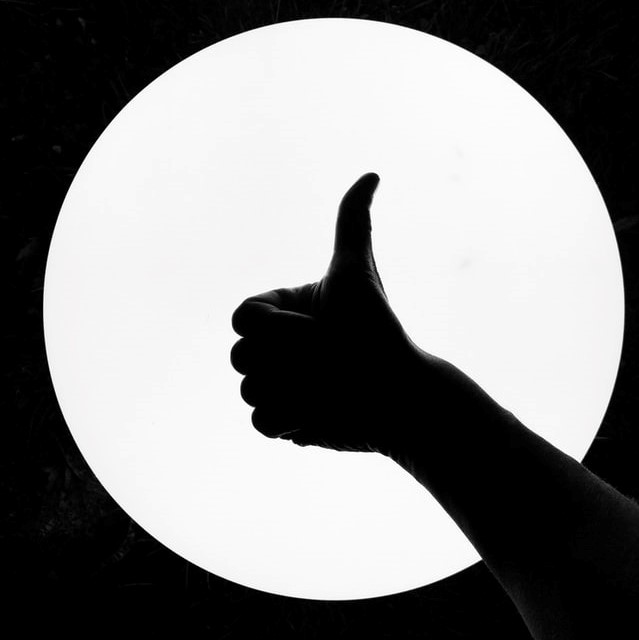 """a """"thumbs up"""" gesture."""